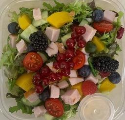 Kip en vruchten bowl